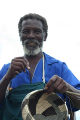 Rueben Ndwandwe weaving a basket at his home.