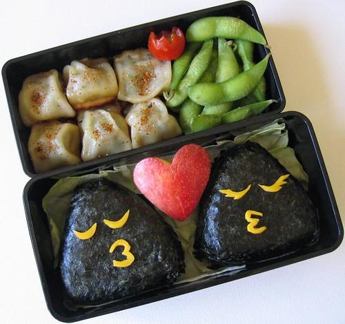 [kissing onigiri bento, dumplings, edamame]