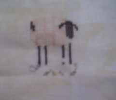 Sheepie on splotchy linen