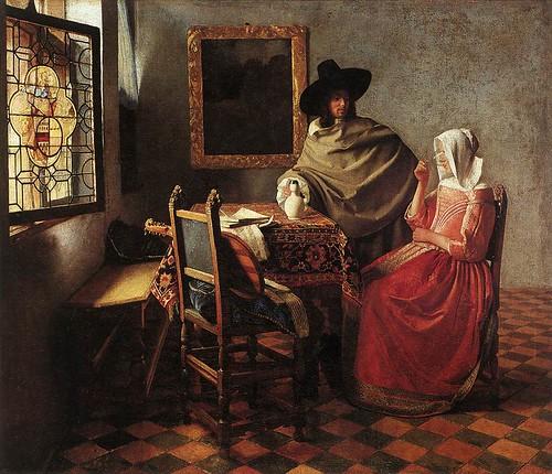 caballero y dama tomando vino-vermeer