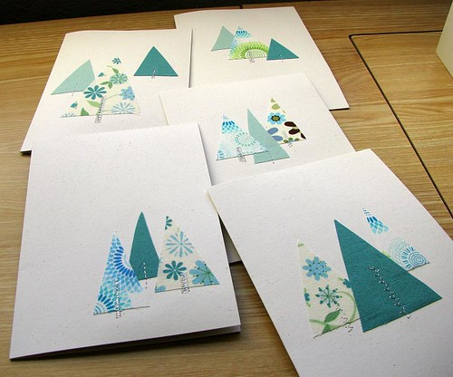 Fabric, stitching, and paper Christmas cards