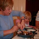 Helping Nanny dish up pudding<br/>20 Mar 2009