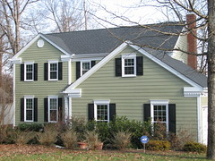 Hardiplank Colorplus Siding in color Heathered Moss and Vinyl Shutters photo by CrownBuilders
