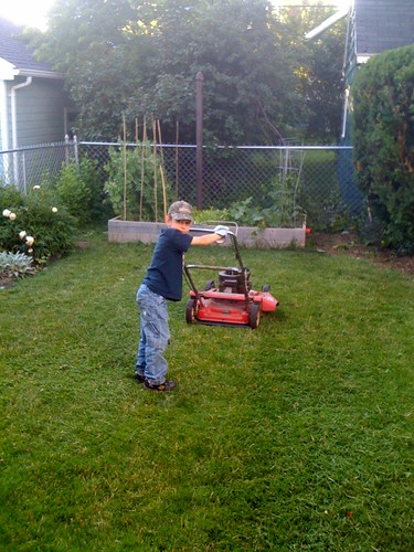 Isaac mows the lawn
