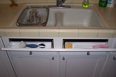 Tip-out sink tray