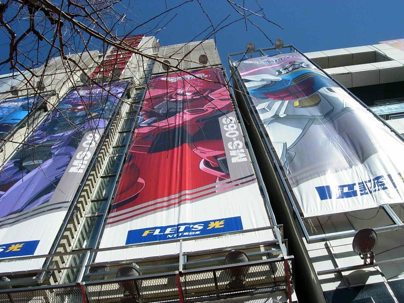 Gundam posters, 3 floors high.