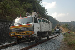 Vehicles modified for riding on rails