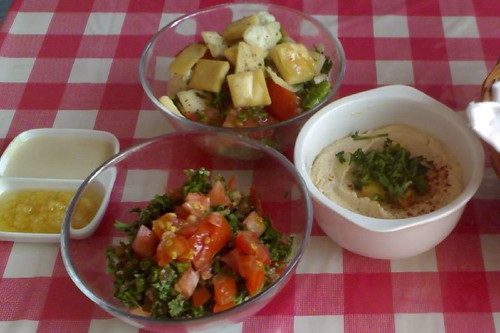 Fom left: garlic dip, tahini, tabbouleh, fattoush, and hommos. RA by KBall