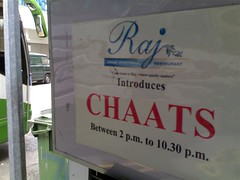 A proud sign outside boasting of the chaat hours