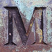 M metal verdigris