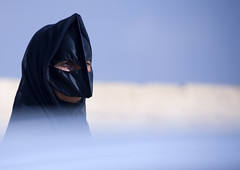 Bedouin woman with a batolah, Oman photo by Eric Lafforgue