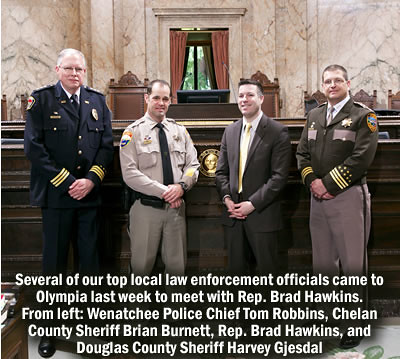 Rep. Brad Hawkins with local law enforcement officers