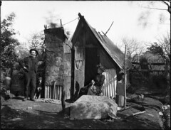 A man and woman outside a bush hut photo by Powerhouse Museum Collection