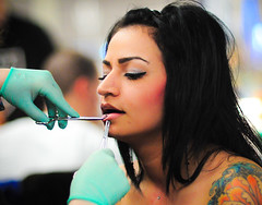 Pretty girl getting her lip pierced photo by tibchris