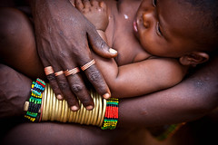 hamer tribe mother and son wearing colored beads and tribal rings, bracelets, iron and copper, lower omo valley, ethiopia. photo by anthony pappone photographer