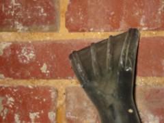 vacuuming out old mortar