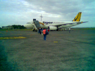 Boarding the Tiger Airways plane