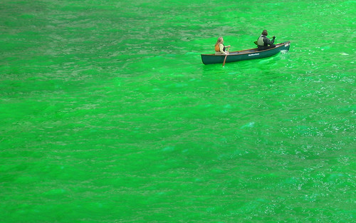 Green boat in green river