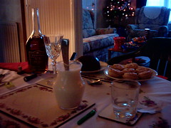 Flickr: Christmas pudding, brandy, white sauce and pies appear on the dinner table