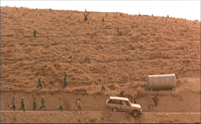 Kiarostami Does Have An Eye For Interestingly Framed Shots Like This One Of Workers Converging On Badiis Car To Push It Out A Ditch