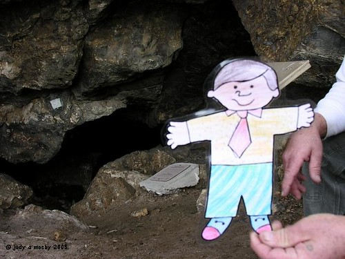 Flat Bobby in front of one of the cave openings