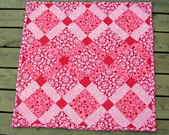 Pink and Red baby quilt photo by cybperry