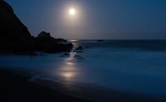 The Full Moon Preparing to Set into the Pacific Ocean photo by AGrinberg