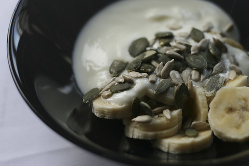 Yogurt and bananas with sunflower and pumpkin seeds