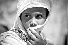 portrait of a girl  outside the St. Mary Zion Church in axum, tigray photo by anthony pappone photography