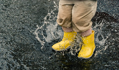 Yellow Boots Splash In A Rain Puddle photo by lestaylorphoto