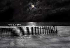 fenced moon photo by marianna_armata