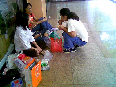 Filipina househelps gather in small corners in Lucky plaza.