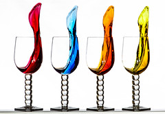 Coloured water leaving four wine glasses photo by Leigh Feaviour