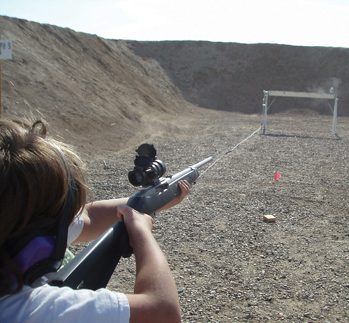 Ashley shooting rifle at Ruger Rimfire