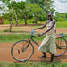 a girl and her bike near Busia