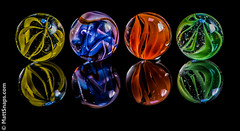 Marbles on black photo by MattSnapsPhotography