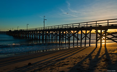Pier and shadows photo by Photosuze