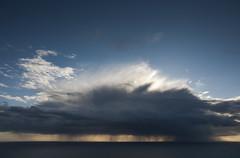 Raincloud off the Pembrokshire coast photo by Keartona