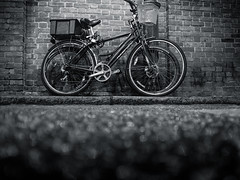 Bicycles on Brick Wall photo by The Nick Page