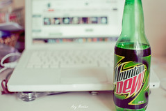Mountain Dew with Macbook white photo by ary mortier