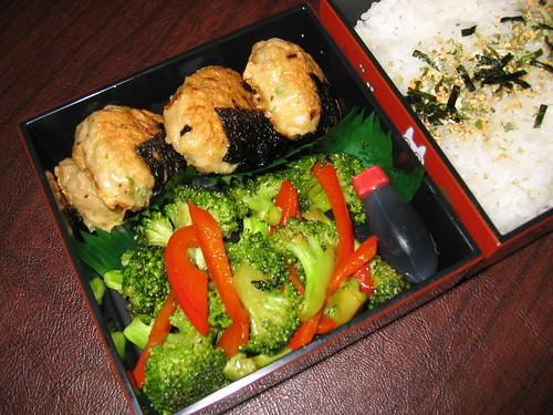 [bento with chicken dumplings and veggie stir-fry]