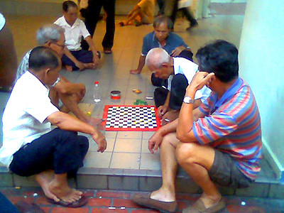Some men playing checkers