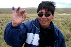 Bolivian Campesino showing off his purple pinky indicating that he has voted