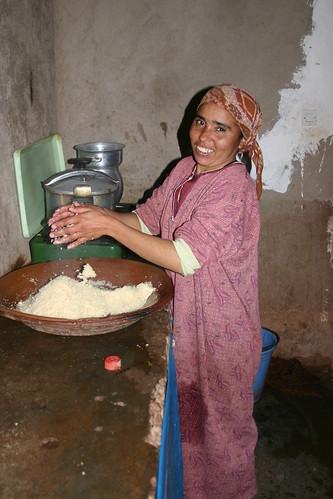 Carefully preparing the couscous dinner