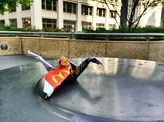 McDonalds bag origami atop garbage can photo by spudart