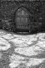 Foreboding door (Knole House, Kent) photo by adammlewis