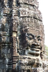 The Bayon was built in the late 12th or early 13th century. It was the last one built at Angkor, and the only one built primarily as a Buddhist shrine. It's most distinctive feature is the 216 massive faces on the many towers which jut out from the upper terrace and cluster around its central peak.