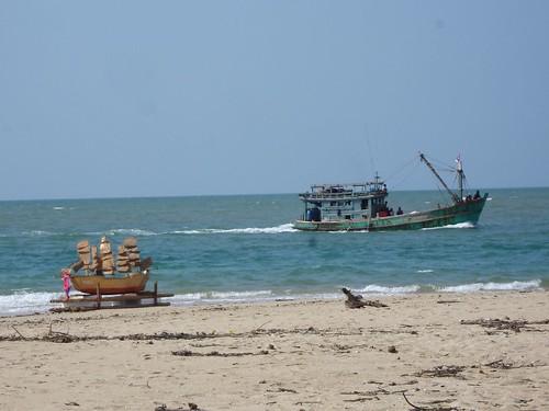 Fishing boat and memorial float at Baan Naam Kem fishing village