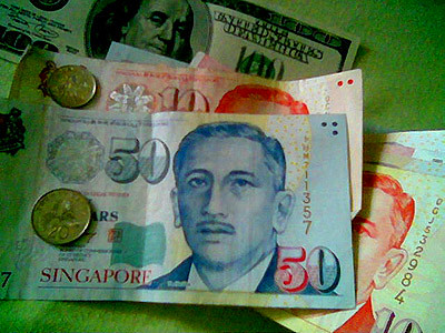 Money, money, and more money. A US dollar bill there and Singapore dollars here.
