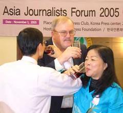 Traditional Korean toast to celebrate the forum